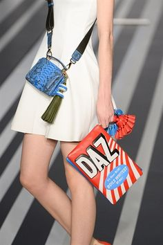 Anya Hindmarch AW14 for LFW. Supermarket inspired clutch-bag using recognisable brand 'Daz'. Models were sent down a conveyor belt runway with shopping trolleys making Anya Hindmarch the chic way to shop.
