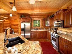 Interior Photos of Log Home Kits | Great Room, Dining Room, Log Home Kitchen