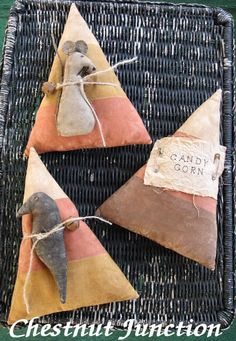 Primitive epattern to makes these 3 variations for Halloween candy corn. One features a mouse, one features a crow, and one is adorned with a stamped muslin lab