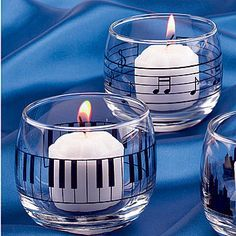 votive candle holders Whether you like playing music or listening to it, a music party theme hits all the right notes. Music Centerpieces, Music Notes Decorations, Piano Keys, Piano Music, Deco Cinema, Music Themed Parties, 50s Theme Parties, Music Crafts, Creation Deco