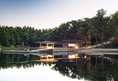 A bothouse in Georgian Bay, Ontario, by Weiss Architecture & Urbanism Ltd. is clad in black-stained resawn cedar.