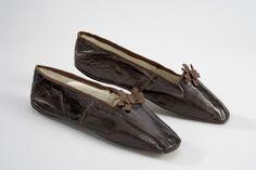 "Slippers, Schenck there l'Allemand à Paris: ca. 1820-1830's, goatskin, lined with linen, insole lined with leather, upper edged in satin ribbon, front decorated with satin ribbon. Label from inner sole: """"SCHENCK DIT L'ALLEMAND, CORDONNIER, BREVETÉ THE SAS Mlle D'ORLEANS, 10 RUE DU 29 JUILLET CI DEVANT 32, RUE DE RIVOLI A PARIS.""  Belonged to Queen Desideria of Sweden/Norway (8 November 1777 – 17 December 1860)."