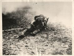 1935- Japanese soldier training war dog for military service. Note that both are wearing gas masks.