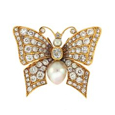 Georgian.This features a natural pearl measuring 10.7 x 8.6mm surrounded by approx 4 carats of old mine cut diamonds in a beautifully made 18KG butterfly brooch.