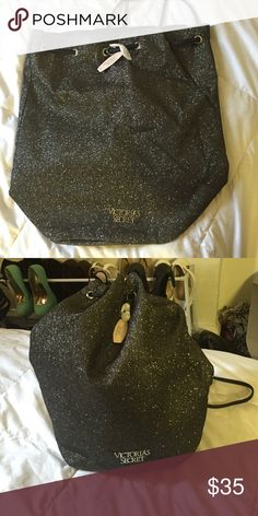 Victoria Secret glitter drawstring backpack Black drawstring backpack with gold and silver glitter all over. Black leather draw strings with silver rivets. Victoria's Secret Bags Backpacks