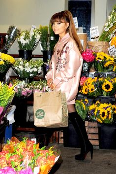 Think thigh-high boots are solely for winter? Nuh-uh. Pair your silky oversized bomber jacket (the boxier, the better) with a pair of over-the-knee bad boys (à Ariana Grande) for an instant update on your summer look. Grocery bag and flowers, optional.
