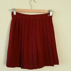 """DONATING 6/30 - MAKE ME AN OFFERMiniskort Made in France side button & zipper closure/great condition/  80% wool/20% polyamide/ full nylon lining Color is like a deep red  Measurements Laying Flat:  Length:  16.5"""" Waist:  12"""" Hip:  17.5""""  (I'd say it fits somewhere btwn 0/2) Tarlazzi Shorts Skorts"""