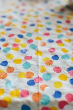 polka dots painted onto drop cloths for a unique tablecloth // photo by TheWhyWeLove.com