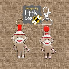 sock monkey key fob AND snap tab design by designsbylittlebee Applique Embroidery Designs, Embroidery Files, Sock Monster, Polymer Clay Kawaii, Softie Pattern, Keychain Design, Stuffed Animal Patterns, Key Fobs, Coco