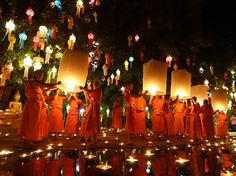 Picture of monks releasing lanterns in Thailand
