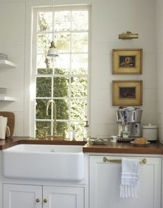 What is the Hottest Decorating Trend 2015 That Is Never Going to Go Away? - laurel home | via Southern Living | love the art and other details in this small kitchen