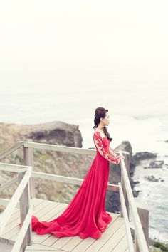 Crimson red gown, with beautiful lace detailing along the sleeves and bodice // Lady in Red: Yuhan and Geraldine's Melbourne Engagement Session