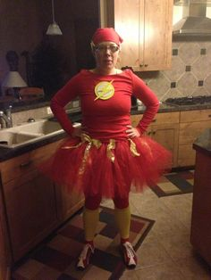 Loving this DIY Flash costume  a female version from Lacee Cantu. made from a red tutu, red top with felt flash logo, red tights with yellow socks and red cap. I wonder if she was wearing this to a running event.