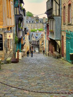 Dinan, France...on of my favourite places to go...this road is very steep and goes right down the hill...gorgeous shops and all old, old ancient buildings ..very beautiful