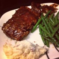Slow Cooker Baby Back Ribs Allrecipes.com. Dredged in flour, browned, seasoned with salt/pepper before putting in the crockpot on low for 10 hrs.  Made sauce of 1T garlic, 1/2c soya, 1/4c brown sugar, 1/3c water, 1/2t ginger, & 1/4c honey.  Brushed on ribs and cooked in oven until brown.  Yum!