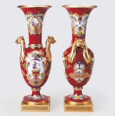 "1780 French Sèvres Vases in the Royal Collection, UK - From the curators' comments: ""Sèvres hard paste porcelain pair of vases. Brick red ground with gilded decoration, oval body, trumpet shaped mouth with gilded monster head handles raised on two fins, circular stem and foot mounted on gilt bronze plinth. Reserves gilded and painted with chinoiserie figures."""