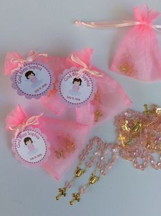24 organza bags with mini rosaries included by Nandospartysupply