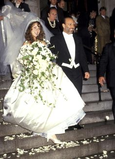 Celebrity Wedding Dress Superlatives: Biggest Flower Arrangement: Mariah Carey.  For Careys first marriage to Tommy Mottola, it looks like she grabbed an alter piece instead of her bouquet.