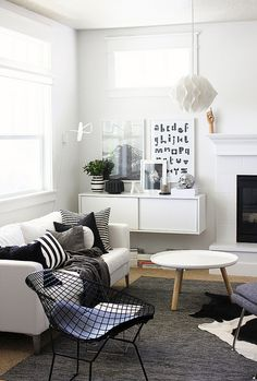 Keeping the colors light, makes the room look larger. The artwork stands out more. You can add a pop of color with a throw or cushion. Here A few black pillows and a wire chair, look amazing!