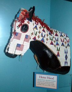 This fully beaded Sioux horse hood. It was used in Fourth of July parades at the turn of the century.