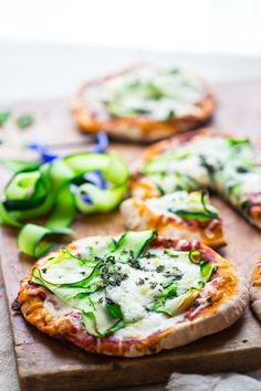 Sponsored:  These 20 minute Zucchini Ribbon Pita Pizzas are a super fast, vegetarian weeknight meal that is also kid friendly. They will be making a regular rotation throughout zucchini season! | Healthy Seasonal Recipes | Katie Webster
