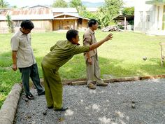 """""""Local law enforcement in Luang Namtha enjoying a game of petangue."""" Humans of Vientiane"""