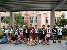 Peace, Love and Kindergarten, end of the year picture. So cute! @Janis Overholt and @Shay think we could replicate this for @Melissa Widmer 's class?