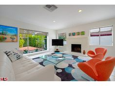 Love the style and the orange chairs look like flowers!  1125 El Alameda, Palm Springs CA 92262 - Photo 1