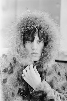 Mick Jagger posing in a fur parka, a sneak peek into Breaking Stones A Band on the Brink of Superstardom. Photographs by Terry O'Neill. (Iconic Images/Terry O'Neill) Mick Jagger Rolling Stones, The Rolling Stones, Maria Callas, Brigitte Bardot, Bruce Springsteen, Melanie Hamrick, Georgia May Jagger, Rock And Roll, Christmas Style