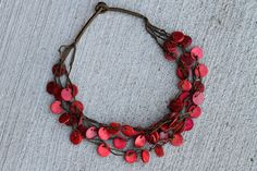 Red Button Necklace -- a great gift and the money all goes to support Made in the Streets, committed to rescuing children from the streets of Nairobi, Kenya.