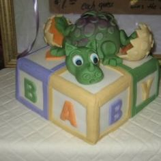 Baby Dragon Cake I got to make a cake for a good friend of mine, she wanted me to include a bay dragon and baby blocks. Baby Shower Buffet, Boy Baby Shower Themes, Baby Shower Cakes, Baby Shower Parties, Baby Boy Shower, Baby Showers, Dragon Baby Shower, Baby Dragon, Dragon Nursery