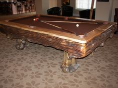 Custom Billiard Tables  These are a few examples of our burled billiard tables. If you want a table with character this is the table for you. As with all of our custom tables you pick out the type of logs, felt, pockets, pocket surrounds and aiming dots. We can also make custom ball racks and cue racks to match you table!!