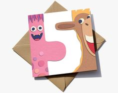 5th birthday card for a boy or girl. The number 5 is in the negative space between a cute monster and a horse/pony.   The cute characters have the appearance of sugar paper giving them a playful quality that children will love.