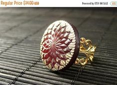 EASTER SALE Maroon Button Ring with Golden Sun Design. Dark Red Ring. Gold Adjustable Ring. Handmade Jewelry. by StumblingOnSainthood from Stumbling On Sainthood. Find it now at https://ift.tt/2Gez2CO!