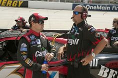 Ricky Stenhouse Jr. and Mike Kelly talk a little strategy before the NNS race at Dover.