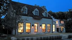 Night front exterior view Modern Cape Cod Cottage in University Park, TX | Richard Drummond Davis Architects