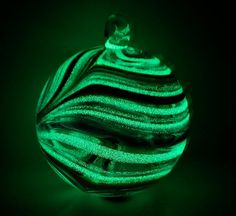 Ornament painted with glow in the dark paint (thegoodtimesglass Etsy Shop)