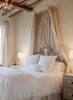 Taupe and white french bedroom-This type of hanging curtain would work perfect for our bed