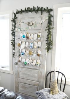 An unused door gets a rustic treatment on the surface so it won't blend into the wall, while cards hang from string for each day of December, creating an epic advent calendar.