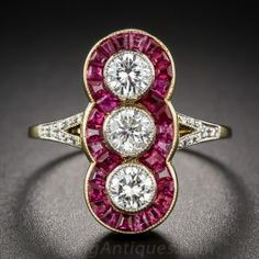 Here is another eye-candy for all vintage style lovers: This dinner ring currently offered by Lang Antique & Estate Jewelry features three H-I colored 0.7 ct. tw. round diamonds, vertically aligned and bezel-set in platinum, framed by thirty 0.7 ct. tw. calibre-cut rubies set in 18 yellow gold, with a split shank decorated by sixteen 0.1 ct. tw. round diamonds for extra sparkle. Pure perfection! www.diamonds.pro