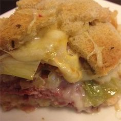 Reuben Casserole - For 1 casserole, we took the idea and made it our own.  Used 1/2 lb. corned beef, cut in cubes, 2 cans of Frank's Bavarian sauerkraut, 3/4 of a bottle of 1000 Island and mixed that all together.  Dried rye or pumpernickel and put some cubes down, added mix and topped with Swiss cheese and bread crumbs.  Baked 20 min at 350 covered, 10 minutes uncovered.  Would probably be good more layered too!