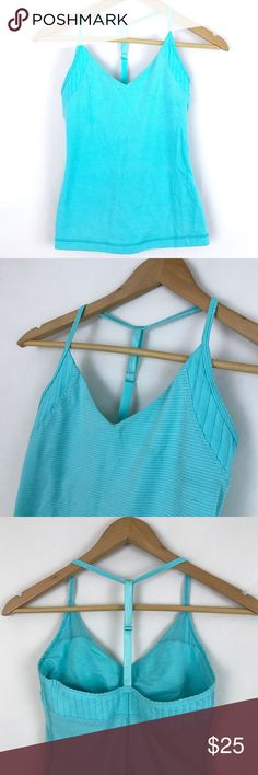 Lululemon Size 4 Turquoise Blue Tank Top Yoga Gym Lululemon light blue striped v neck halter racer back workout tank top. Built in bra, room for pads but no pads included. Size 4. Excellent condition.   Measurements by request. lululemon athletica Tops Tank Tops