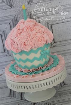 Chevron Buttercream Rosette Smash Cake - I made this smash cake for a photo shoot. Rosettes are piped in buttercream and chevrons are cut out of fondant. This matches the little Birthday girl& outfit, exactly. but the top in BLUE Fancy Cakes, Cute Cakes, Pretty Cakes, Beautiful Cakes, Amazing Cakes, Beautiful Birthday Cakes, Big Cupcake, Giant Cupcake Cakes, Beaux Desserts
