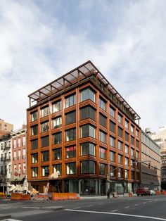 A grid of terra-cotta frames the glass walls of a new residential building by Selldorf Architects in New York's trendy NoHo neighborhood. Read on to see more buildings with terracotta façades.
