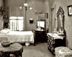 So helpful to see! Nice simply lace curtains with shades behind them, and a simple chenille or matelasse coverlet. Lovely!  Shorpy Historical Photo Archive :: Bedroom 1920s