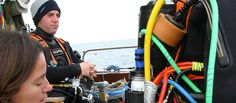 Accessories for underwater welding including compasses, diving knives and rope.