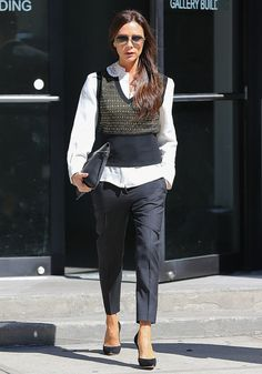 Victoria Beckham sure knows how to rock a white button-down under a vest.