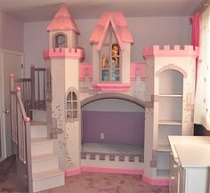 this playful pink bedroom is any little princesss dream the custom castle features a cozy loft bed nestled within fortress walls and a slide down