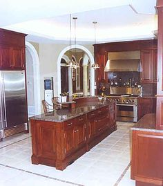 Stately and Cultivated Mahogany Kitchen: Add timeless elegance to a hard-working kitchen with hand-crafted cabinets