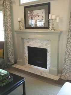 idea for fireplace mantle and surround? Wall color very close to our living room.